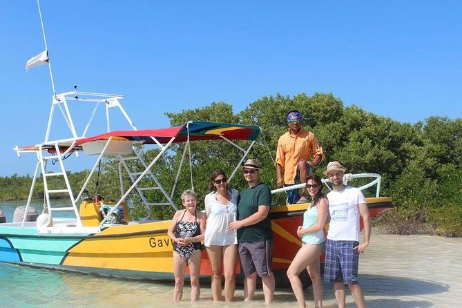 Relaxing tour to Cabo Catoche with fishing and snorkeling on a shared boat