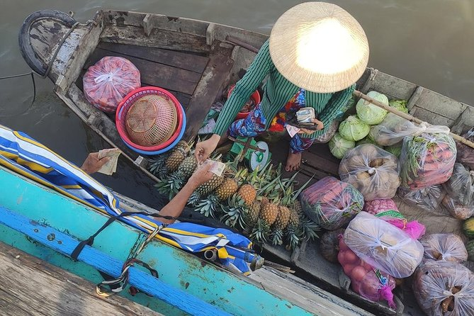 Cai Rang floating market and cyling in village to see real Mekong life