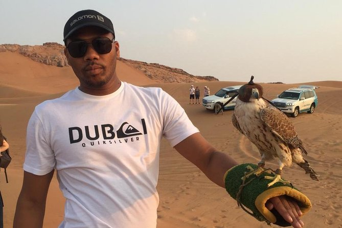 Morning Desert Safari in Red Dunes & Sand Boarding with Photography from Dubai