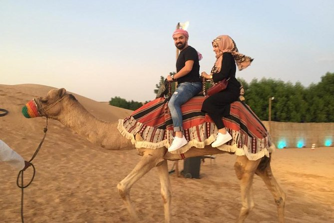Evening Red-Dunes Safari Dubai,Quad Bike,Camel Ride,SandBoarding,BBQ,DuneBashing photo 3