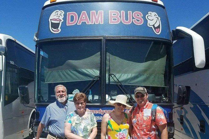 More happy dam tourists in front of their dam bus.