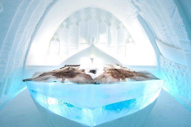 Guided tour of ICE HOTEL and REINDEER feeding at the Sami Camp Museum and church
