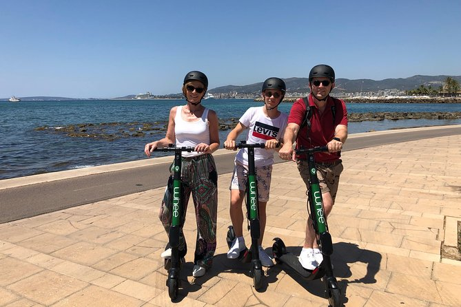1h10min PRIVATE Tour with PREMIUM e-scooters visiting Palma old town