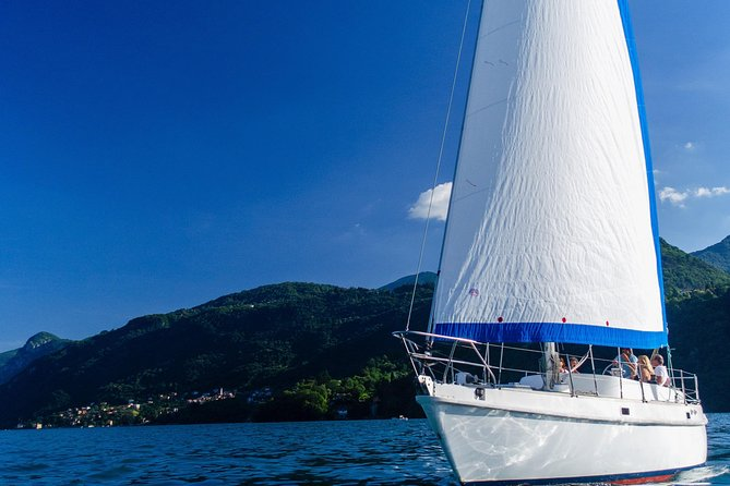 Sunset sailing on lake Como with private skipper