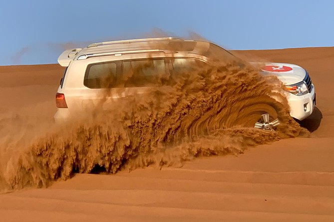Private Premium Red Dunes Desert Safari with VIP BBQ Dinner and Camel Trek