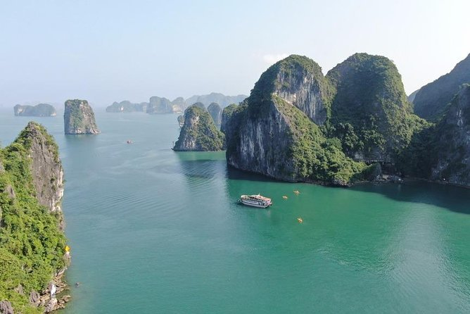 Halong bay 7 hours cruise trip: visit pristine places, kayaking, swimming, lunch