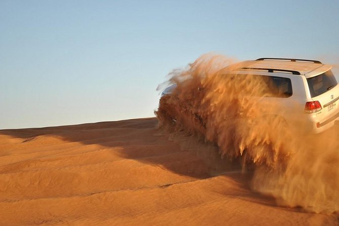 Private Desert Safari With Quad Bike Sand Boarding and BBQ Dinner