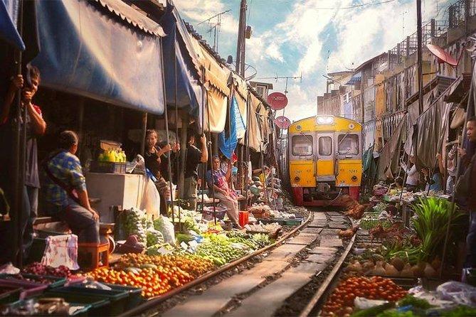 Maeklong Railway Risky Market & Damnoen Saduak Tour