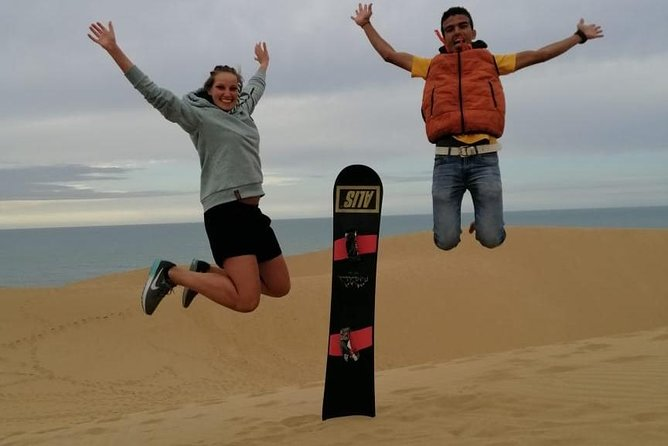 Sandboarding ( sandsurfing ) with lunch in berber house