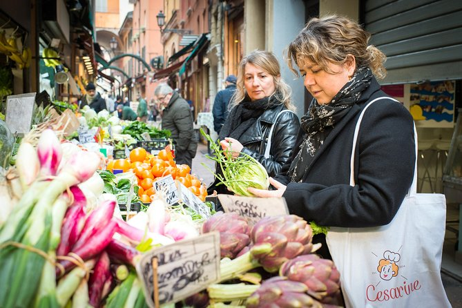 Local market visit and dining experience at a local's home in Bologna