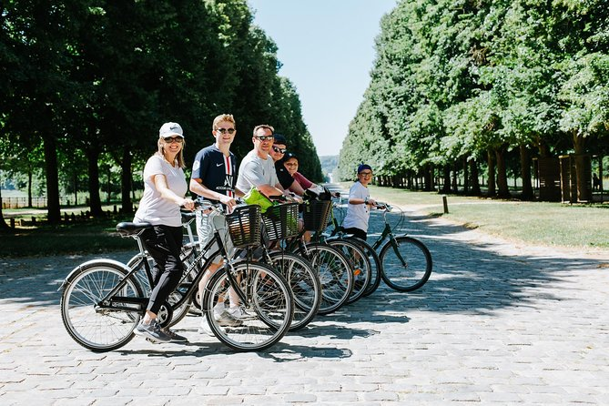 Versailles Domain Guided Day Bike Tour with Palace Access from Paris by Train