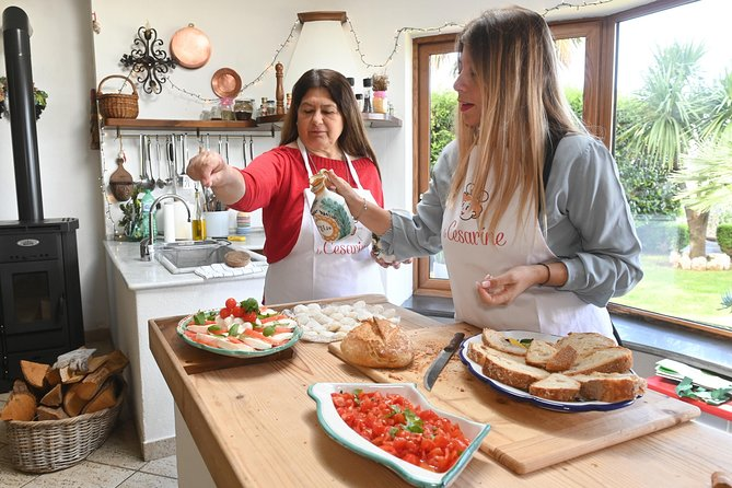 Private cooking class at a local's home with lunch or dinner in Amalfi