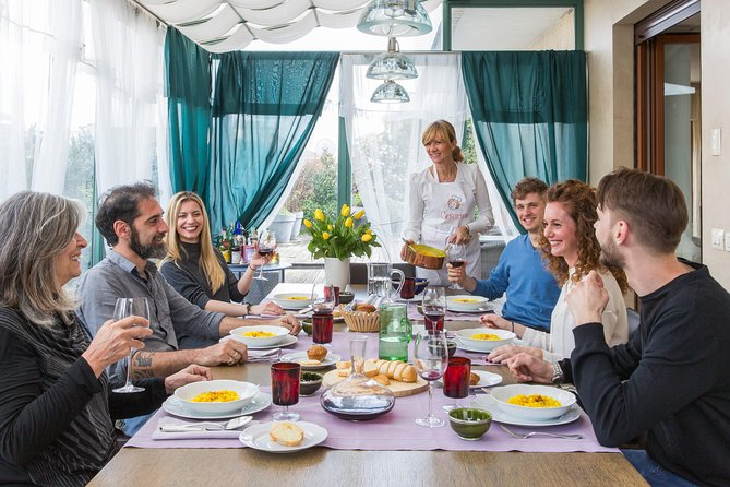 Dining experience at a local's home in Milan with show cooking