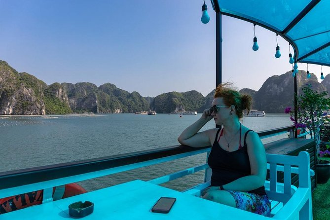Halong bay 6 hours shared boat tour from Halong city Start at 8.00 AM photo 1