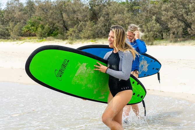 Waves & Wheels | Noosa Surf Lesson, electric-Mountain Bikes (Half Day)