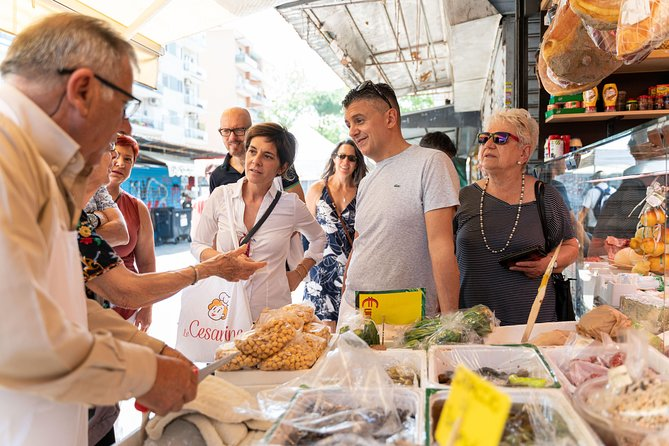 Local market visit and private cooking class at a Cesarina's home in Rome
