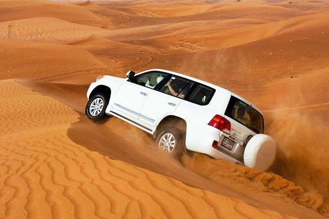 Private Desert Safari With BBQ Dinner, Camel ride & Sand-boarding