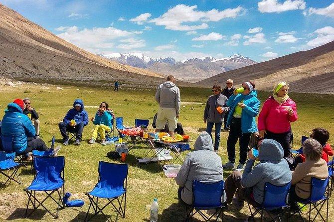 Picnic lunch with view to Hindu Kush Range. Khargush pass 4344m
