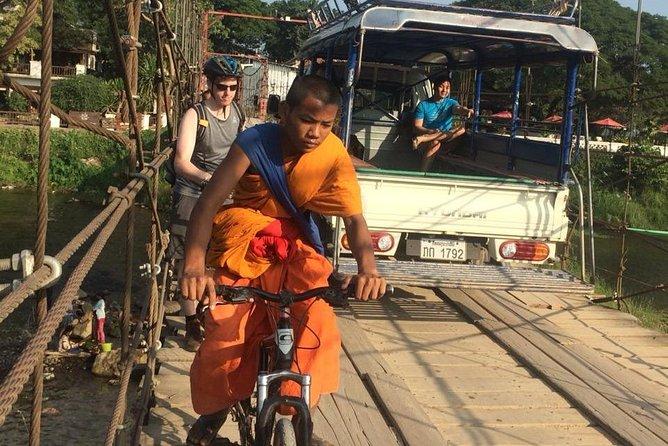 Arrival Day, Full day Explore Luang Prabang Ancient City and Kayaking on Namkhan River, Visit Village Nong Luang Village and Mountain Bikes,300 Monks Morning Alms, Trekking a Waterfall,