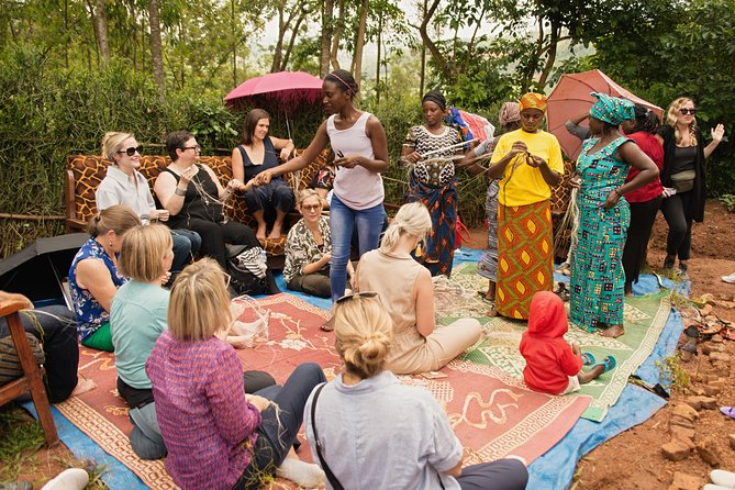 Jane - Akilah alumnae - teaching visitors traditional Rwandan weaving.