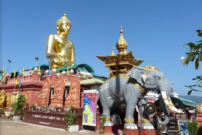 ChiangRai:Jointour 1 day White temple+Baan dam+Golden Triangle+Maesai+Boat trip photo 4