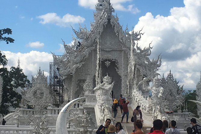 ChiangRai:Jointour 1 day White temple+Baan dam+Golden Triangle+Maesai+Boat trip photo 2
