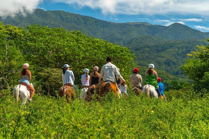 Visita combinada con tirolina, paseo a caballo y aguas termales