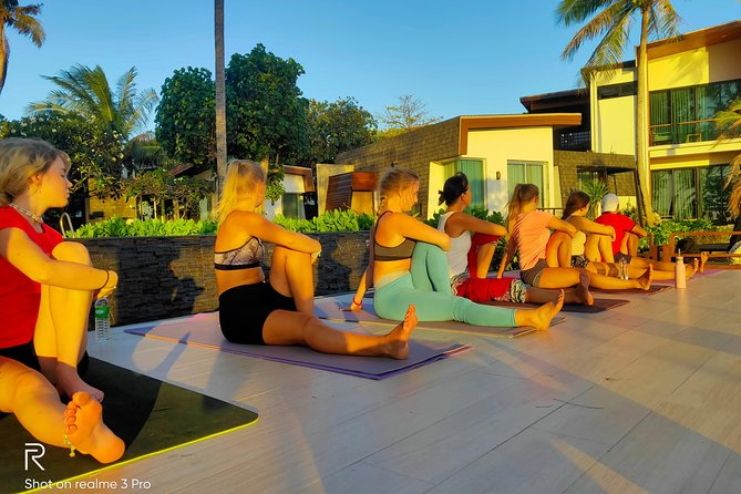 Sunrise yoga class overlooking the beach, the sea & sunrise @ Idyllic resort.