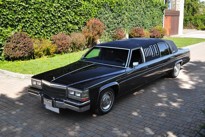 Airport transfer by a 1984 Cadillac DeVille Limousine