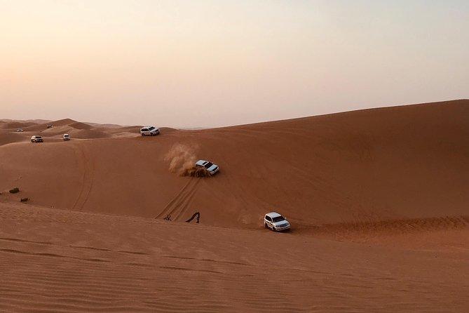 Abu Dhabi Desert Safari with BBQ Dinner,Sandboarding & Camel Ride