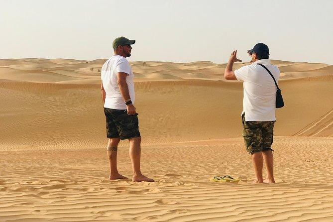 Abu Dhabi Morning Desert Safari.Dune Bashing,Sandboarding and Camel Ride