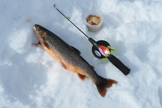 Snowshoeing and ice fishing in a lake outside Alta photo 1