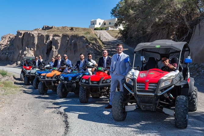 Cruise through the magical villages of Santorini on our ATVs, Scooters, or Cars photo 1