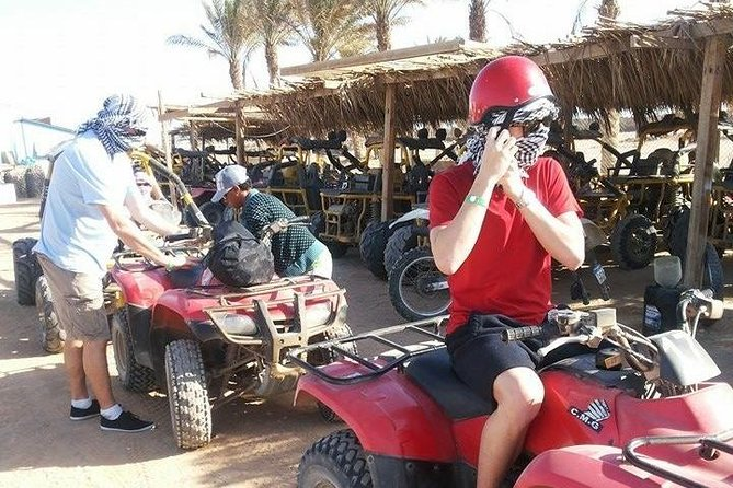 quad bick with camels riding and beduin dinner