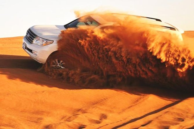 Abu Dhabi: 7-Hours Desert Safari with BBQ, Soft Drink, Camel Ride & Sandboarding