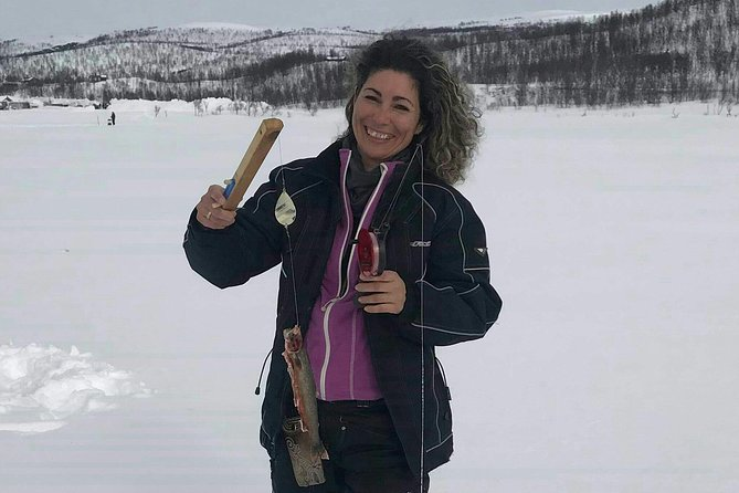 Snowshoeing and ice fishing in a lake outside Alta photo 6