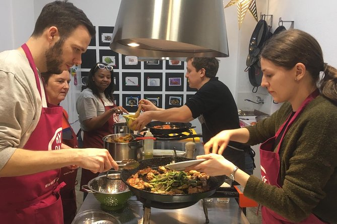 Seafood Paella cooking class, tapas and visit market