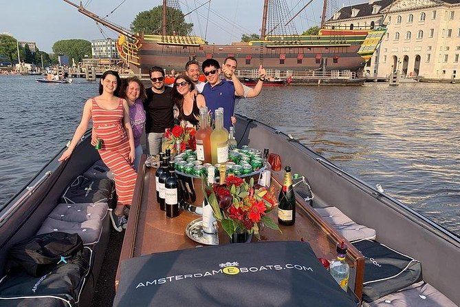 €18 Amsterdam E boats 1hour canal cruise & €7 for unlimited open beer & wine bar
