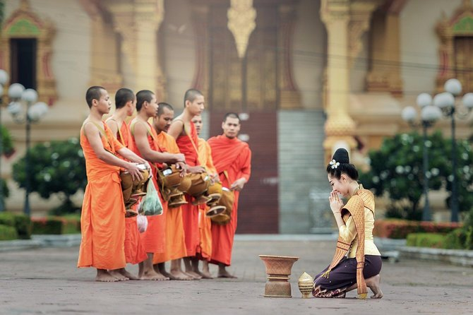 Sunrise blessing walk towards famous temple with fruit and flower donation