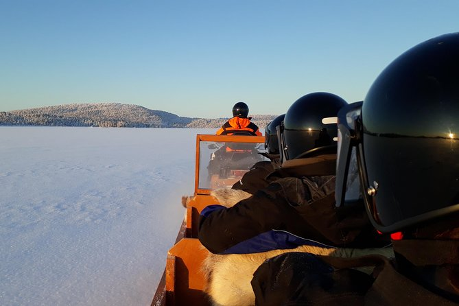 Visit a Authentic Reindeer Farm by Snowmobile sleigh ride photo 6