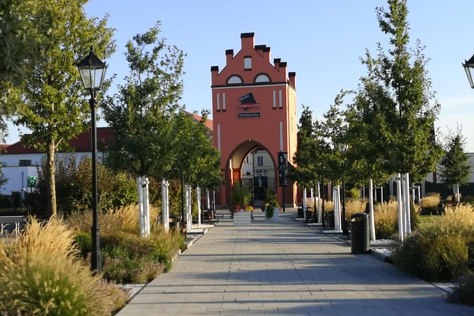 Designer Berlin Outlet Mall (Shopping Tour) by public transfers with Local Guide