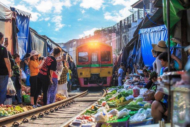 Visit the famous Maeklong Railway market & Damnoensaduak Floating Market