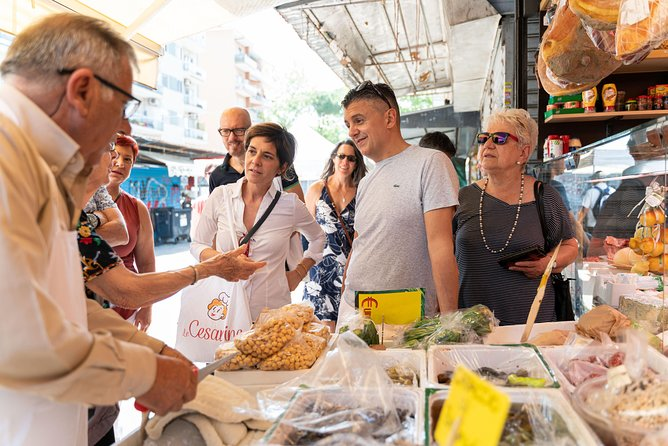 Market visit and cooking class with lunch or dinner at a local's home in Amalfi
