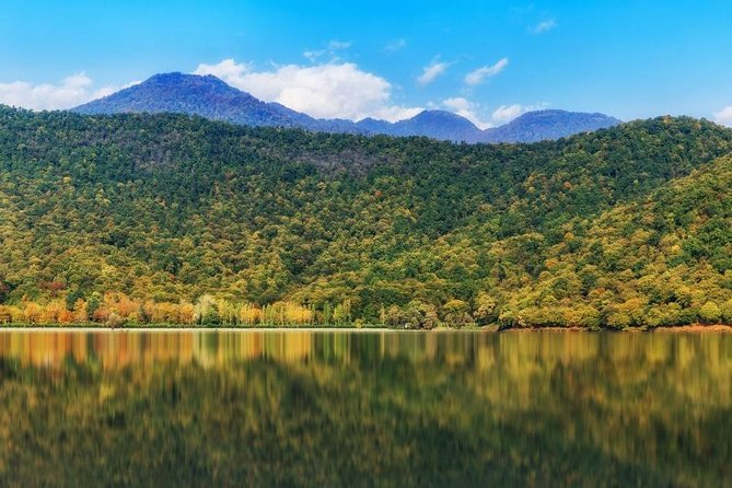 Magnificent view to the Caucasus Mountains through Nohurgol Lake