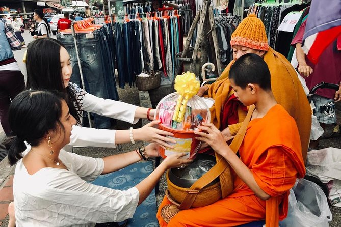 Discover the charm of Chiang Mai. Alms Giving to Monk and Temple.
