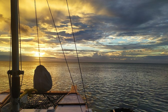 Sunset with a homemade traditional sailing canoe