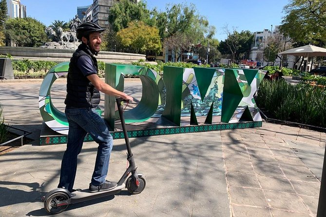 Electric Scooter Sightseeing + Taco Experience in CDMX photo 1