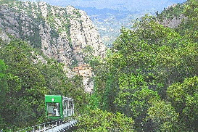 Private tour to Montserrat. The most complete tour, Cable car & meal included photo 8