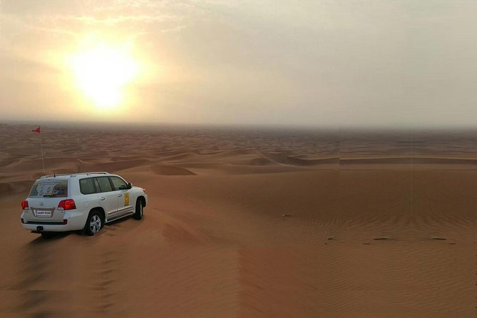 Morning Dune Bashing With Sand Boarding And Camel Ride in Red Dunes Desert