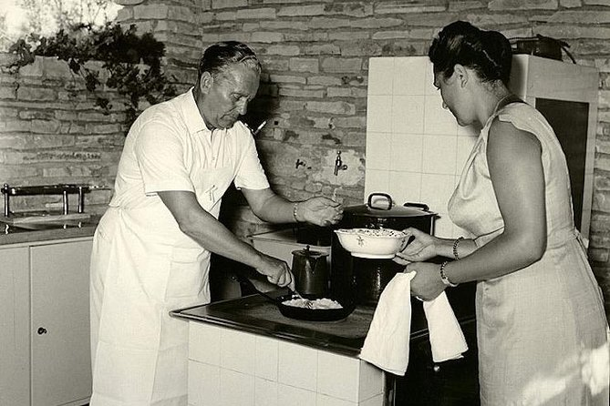 Tito and his wife Jovanka cooking.